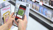 Telefony są coraz częściej używane podczas zakupów. Na zdjęciu aplikacja RedLaser dla iPhone'a.