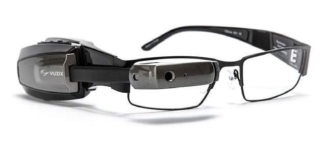 Okulary Vuzix M100 wykorzystywane w systemie AR w magazynach, zintegrowane z systemem logistycznym T-Systems Global Integrated Manufacturing Manager.